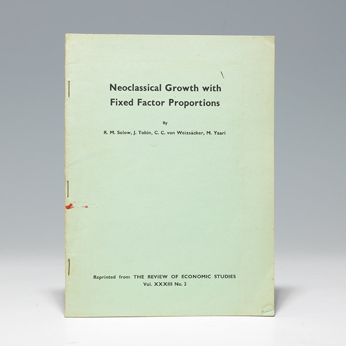 Neoclassical Growth with Fixed Factor Proportions
