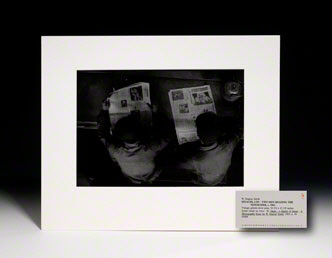 Photograph. Two Men Reading Newspaper